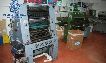 A printing press found inside a warehouse in Elche, Alicante province.