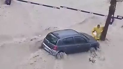 A man is carried out to sea after trying to reach his car.