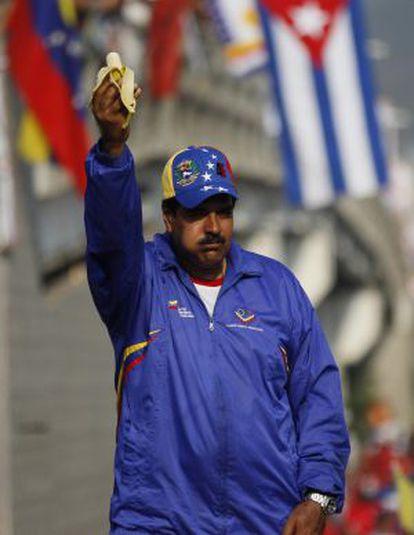Venezuela's acting President Nicolás Maduro eats a banana during a presidential election campaign rally in Catia La Mar.