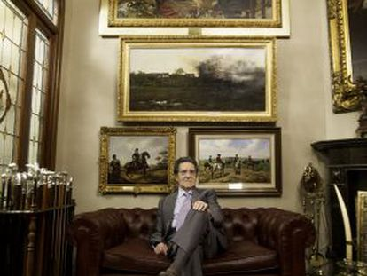 Mariano Bellver inside his home, with a few items from his collection on display.