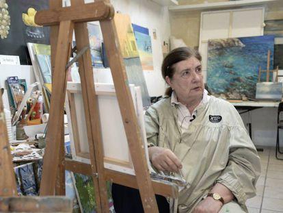 Retired translator Ute Rebholz paints a canvas.
