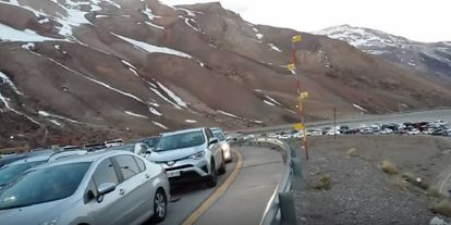 Cars wait to cross into Chile from Mendoza, Argentina.