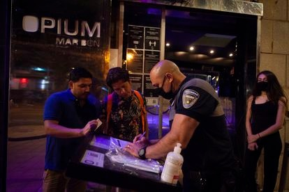 Taking down customers' contact information at Opium club on Saturday.