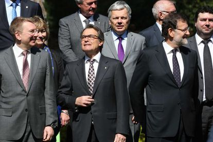 Catalan premier Artur Mas (second from left) and Prime Minister Mariano Rajoy (right) with EU foreign ministers in Barcelona.