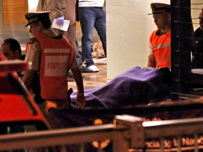 The body of prosecutor Alberto Nisman is carried out of his apartment on Sunday.