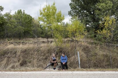Two locals chat on the road to Madarcos, the village with the fewest residents in the Madrid region – just 40.