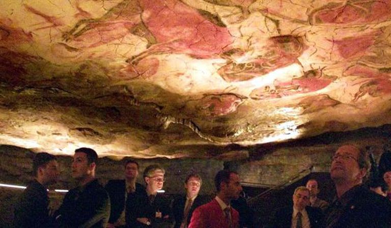 Visitors inside the replica of the Altamira cave in Cantabria.