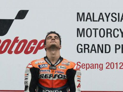 Honda rider Dani Pedrosa of Spain listens to the national anthem on the podium after winning the Malaysian MotoGP.