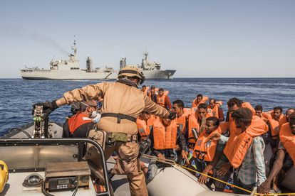 A group of migrants from the Ivory Coast in the ship after being rescued close to Libyan territorial waters.