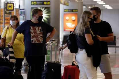 Passengers traveling to the UK in Tenerife Sur airport.