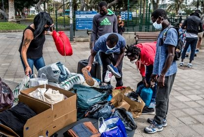 Senegalese migrants receiving clothes donated to the Somos Red support group in Gran Canaria.