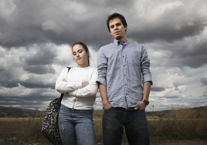 """Almudena Pérez, 17, and Gabriel Garretas, 24, in Torremocha. """"Our childhood was playing in the street until the small hours of the morning and feeling safe,"""" says Pérez."""
