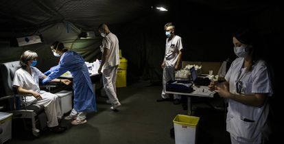 A field hospital in the Spanish region of Asturias tests health workers for coronavirus.