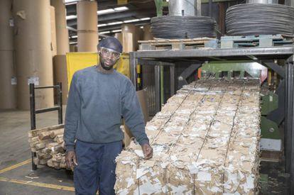 Hagie Waggeh, an employee at the cardboard manufacturing company Cartonajes Izquierdo.