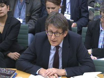 Editor of 'The Guardian' newspaper Alan Rusbridger gives evidence to the Commons Home Affairs Committee hearing on December 3, 2013.