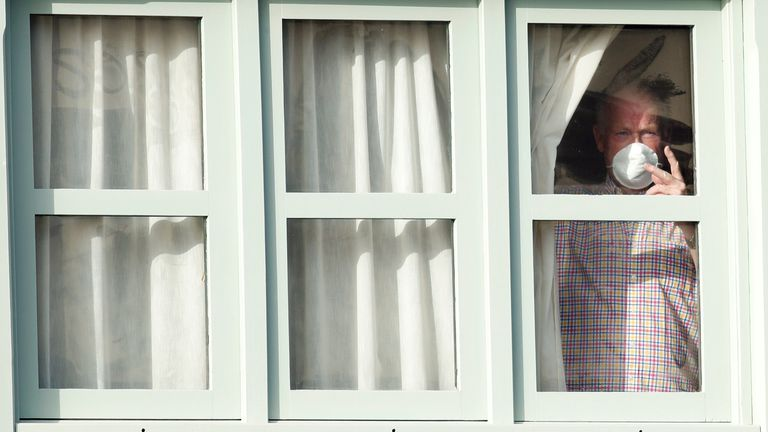 A tourist in the H10 Costa Adeje Palace hotel, which is on lockdown after coronavirus cases were confirmed among guests there.