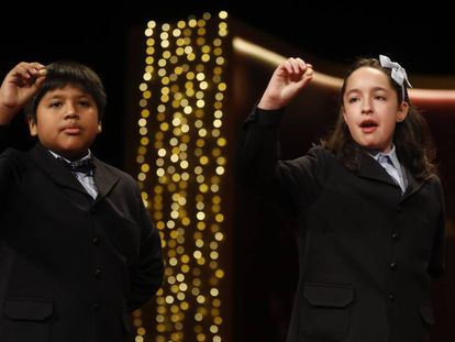 Children at Madrid's San Ildefonso school sing out the winning lottery numbers.