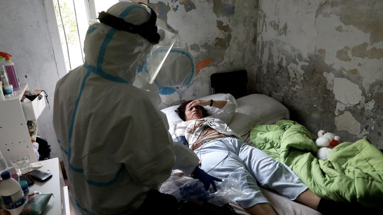 Doctor Marta Calvo, from the SUMMA emergency crew, attends to Mónica Rosario in her home in Madrid.