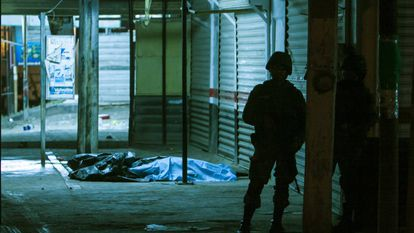 A soldier at the scene of a shooting in Culiacán.