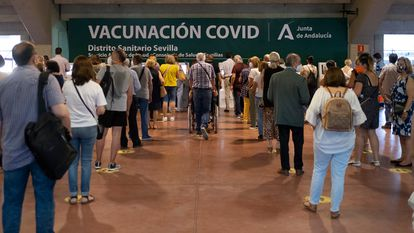 People wait in line to be vaccinated at the Estadio Olímpico in Seville on Thursday.