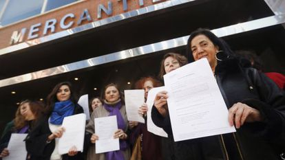 A group of women register ownership of their bodies with the Mercantile Registry on Monday as part of an abortion reform protest.