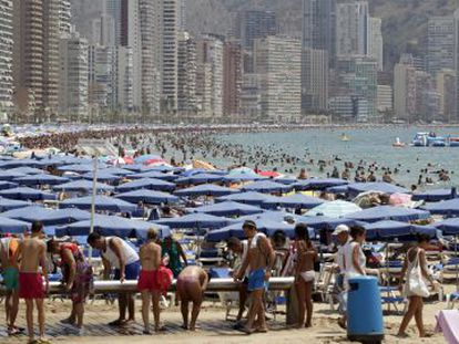 Tourists fill the beach in Benidorm this past summer.