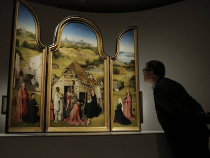 A visitor examines the 'Adoration of the Magi.'