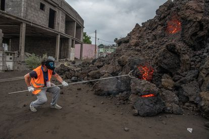A technician from the Volcanology Institute of the Canary Islands (Involcan) takes a lava sample in Todoque on Wednesday.