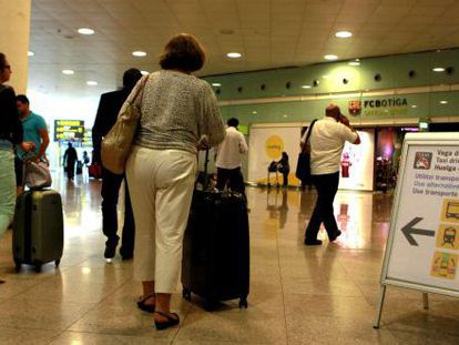 Passengers at Barcelona's El Prat airport.