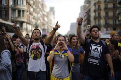 Protesters shout slogans against Supreme Court verdict in Barcelona.