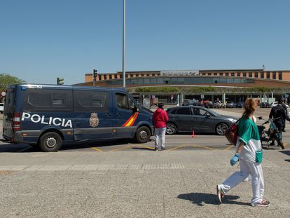 Police conducting vehicle checks outside Santa Justa station in Seville.