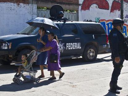 Soliders patrol the streets of Aguililla, Michoacán on July 25.