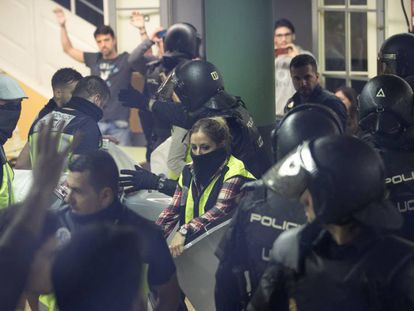 National Police officers seize ballot boxes on October 1.