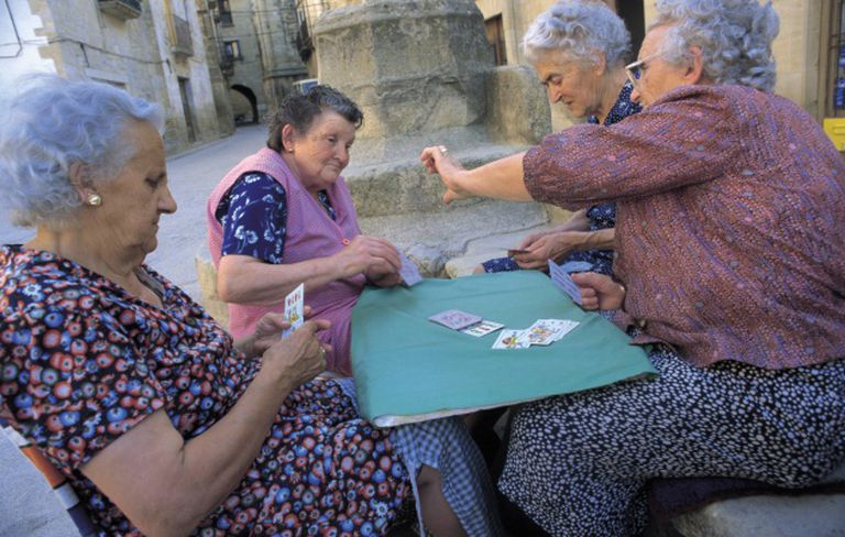 Women in a Spanish village enjoying some fresh air.