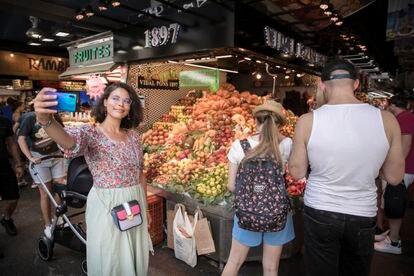 Tourists in Boqueria market in Barcelona.
