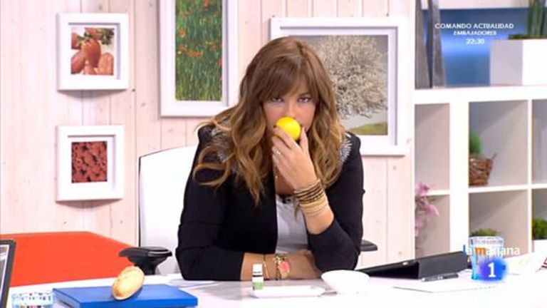Presenter Mariló Montero smells a lemon on her morning show.