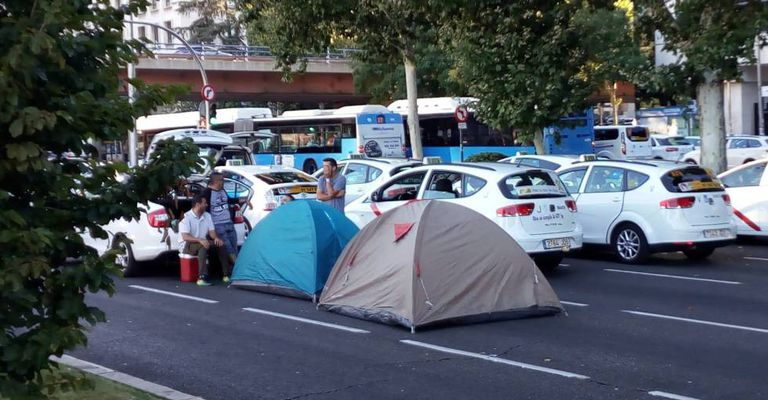 Taxi drivers camp in a central avenue in Madrid.
