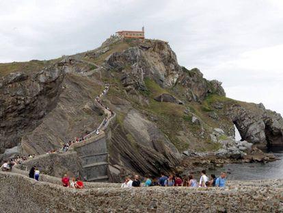 Tourists at the San Juan de Gaztelugatxe hermitage in Bermeo.