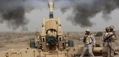 Saudi soldiers fire artillery at the Saudi border with Yemen in this file photo from April 2015.
