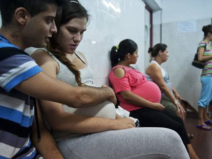 A young mother at a medical clinic in Buenos Aires.