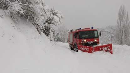 Firefighters in Catalonia clearing snow from the road.