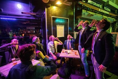 A group of young men celebrate the reopening of nightlife venues in the Netherlands two weeks ago.