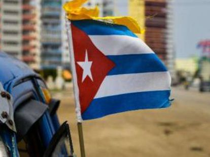 A Cuban flag on a Florida beach.