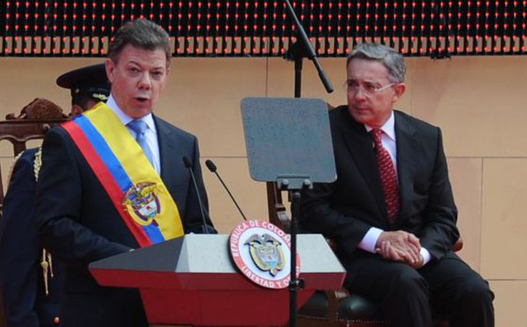 Uribe, right, at Santos' inauguration in 2010.