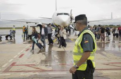 Passengers disembark from the Ryanair flight.