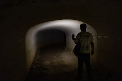 Carlos Jordán, from the San Roque tourism department, shines his flashlight on the tunnel that stretches around 500 meters under the Sierra Carbonera in La Línea de la Concepción.