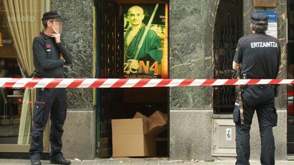 Ertzaintza police officers keep watch over the martial arts premises in Bilbao where human remains have been found.