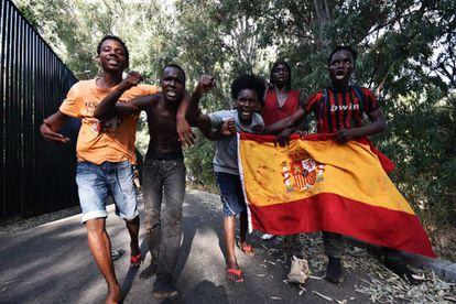 Migrants celebrate their arrival in Ceuta.