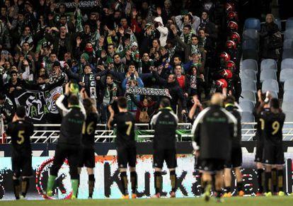 Racing players applaud their fans at the Anoeta stadium.