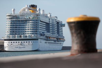 Passengers are seen onboard the Costa Smeralda cruise ship of Costa Crociere, carrying around 6,000 passengers, as it sits docked at the Italian port of Civitavecchia following a health alert due to a Chinese couple and a possible link to coronavirus, in Civitavecchia, Italy, January 30, 2020. REUTERS/Guglielmo Mangiapane